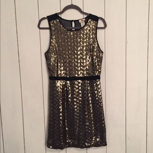Gold sequin mini dress with sheer back. Size s